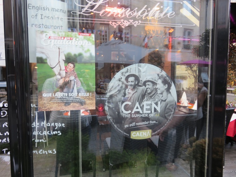 Commemorative decals were placed in several store and restaurant windows in honor of the 70th anniversary of the D-Day landings during WWII.